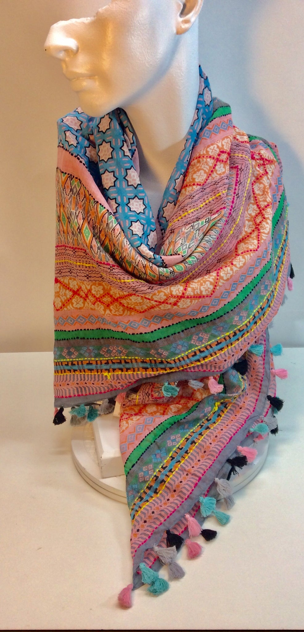 Multi coloured square scarf with tassels
