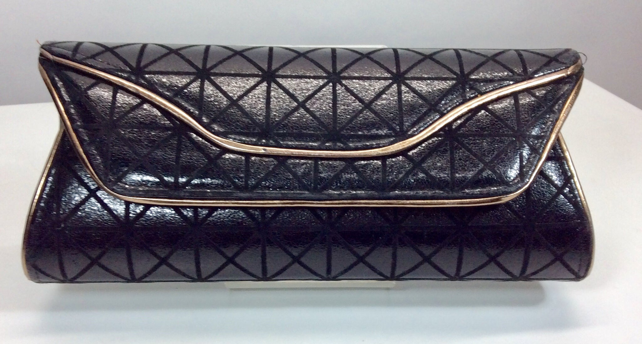 Elegant shimmering self embossed black evening bag with gold detail