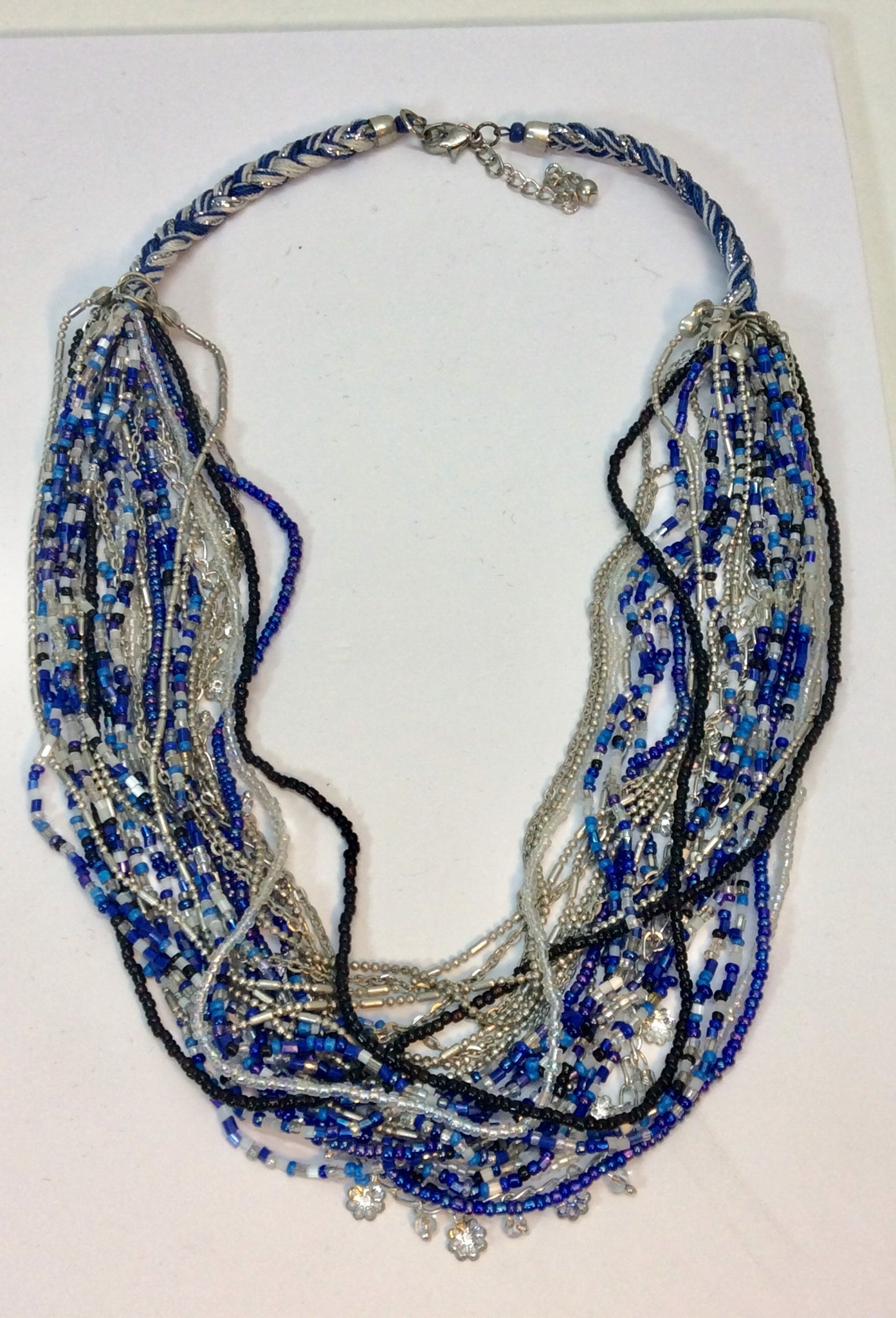 Unusual multi stand.necklace with blue and silver beads