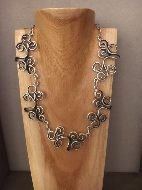 Beautiful swirly patterned necklace.