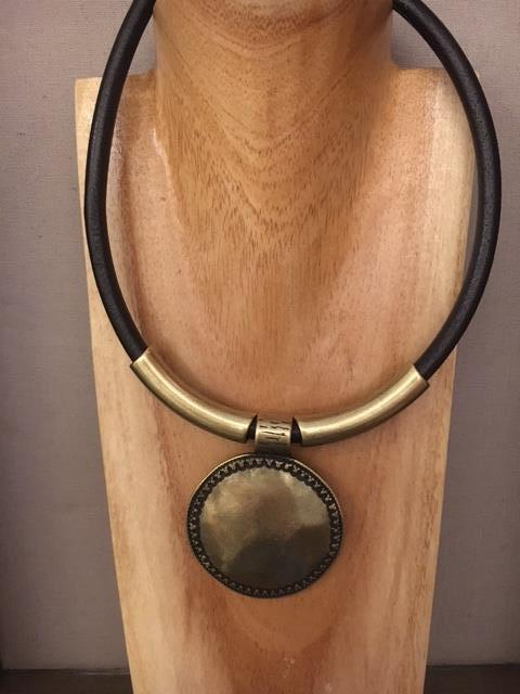 Gold disc on black leather necklace
