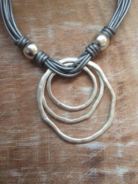 Multi strand silver circle necklace