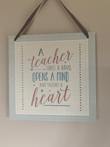Teacher touches a heart sign