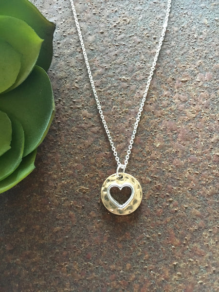 Worn gold plated disc silver heart outline necklace