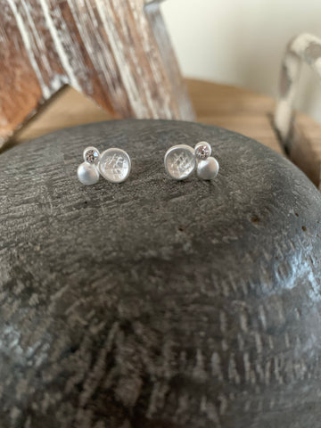 Silver coloured stud earrings with diamanté detail