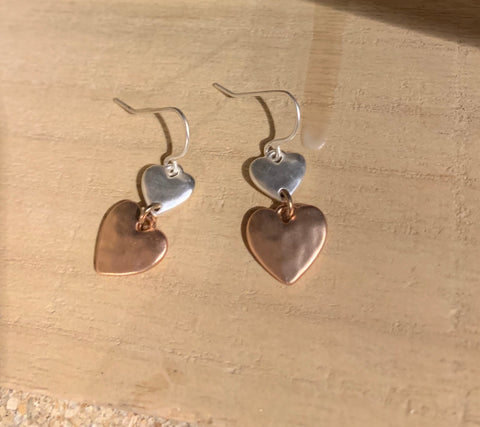 Silver & rose gold coloured dangly heart earrings