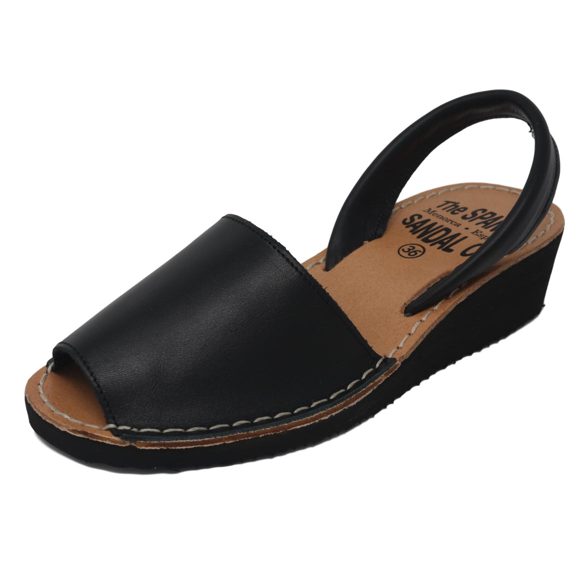 Black wedge sandals - diagonal view