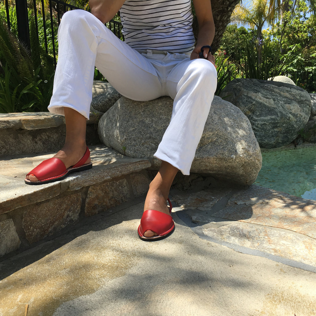 Classic red sandals with white pants  - Instagram