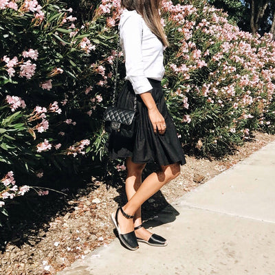 black spanish sandals dressed up with black skirt