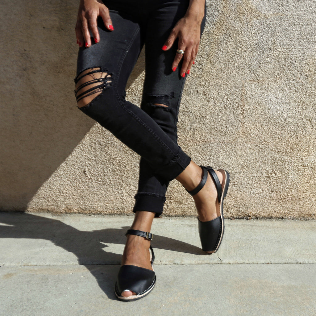 Instagram - black spanish sandals with ankle straps worn with black jeans
