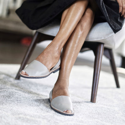 Close up Classic taupe sandals  with black skirt - Instagram