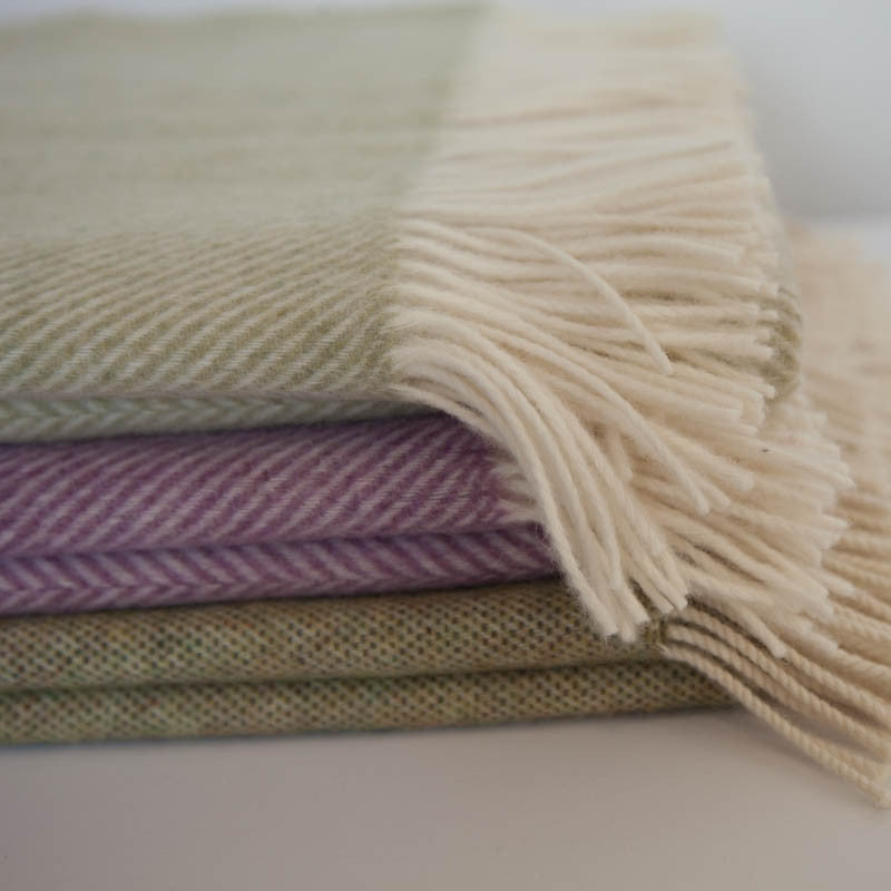 stack-of_soft_herringbone_wool_throws