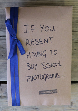 Buy this book if you resent having to buy school photographs
