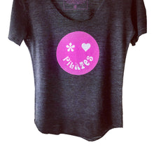 Pilates tee with bright colored Pilates face on gray t-shirt