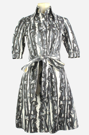 Bessie dress in a black, grey and cream chain print on a mannequin, front view, by A Child of the Jago