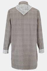A loose long length cotton shirt in black check with a contrasting black stripe bib, cuff and necktie detail, back view, by A Child Of The Jago
