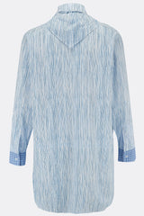 A loose long length cotton shirt in blue stripe with a contrasting blue check bib and cuff detail, back view, by A Child Of The Jago