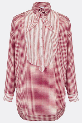 A loose long length cotton shirt in red check with a contrasting red stripe bib, cuff and necktie detail, front view, by A Child Of The Jago