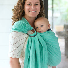 Image of woman wearing baby in Studio Tekhni mint ring sling
