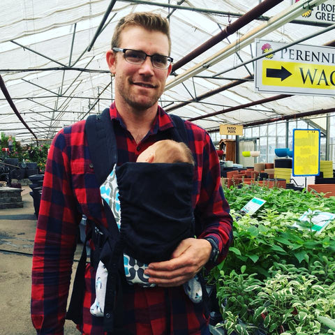 Image of man wearing baby in Catbirdbaby Pikkolo Baby Carrier