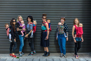 picture of 6 women wearing babies on their front or back in an integra baby carrier