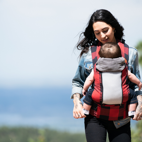 Image of woman wearing baby in Beco 8 Baby Carrier