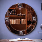 Round brass mirror with magnifying glass