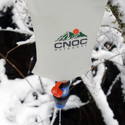 Orange CNOC Vecto Water Container - Attached to a sawyer to make a gravity filter