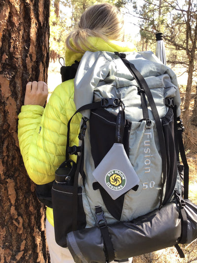 Wander Woman wipe - attached to a Fusion 50 Backpack