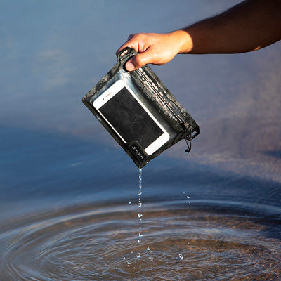 Nite Ize Runoff Waterproof Pocket with cell phone inside being taken out of the water