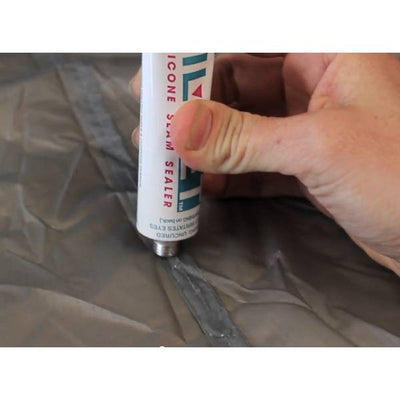 Gear Aid Seam Grip + Sil (SilNet) being applied to a tent