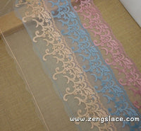 Pink, blue and yellow embroidery on mesh lace, about 7 1/2 inches wide, castteam lace trim, priced for 1 yard. ee-28-x