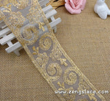 Gold lace ribbon embroidered on organza with oval patterns, about 2 1/4 inches wide , priced for 1 yard. EE-09-01