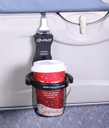Cup-Pilot portable beverage holder hands from the seat-back tray while closed