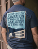 "Shirt Back - ""Brushy was the damnation of many an evil man, and the salvation of a humble few."" with prison wall displayed below."