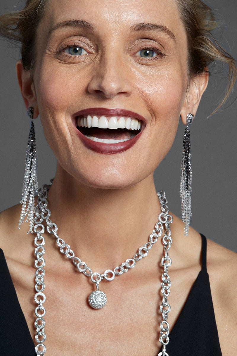 Smiling woman with multiple necklaces and Diamond Fringe Earrings