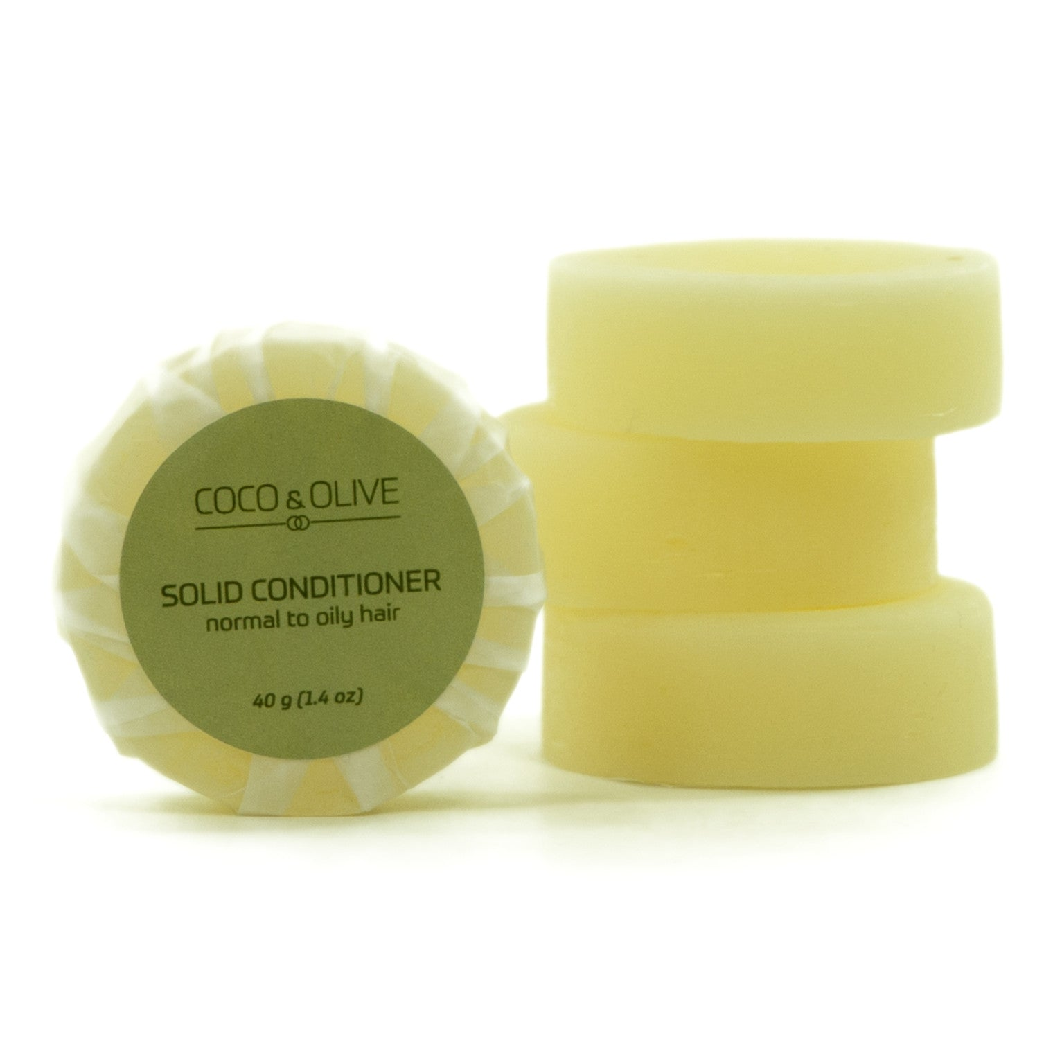 Coco & Olive Solid Conditioner Refill Normal to Dry hair. Refills are packaged simply in recycled paper.