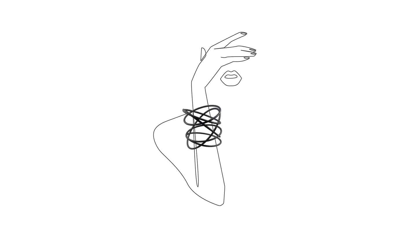 3D Printed Orbit Bangle Bracelet in Carbon Black on an illustrated sketch of a woman's arms and lips