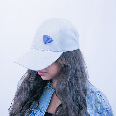 GAMENT 3D Printed Blue Diamond Magnetic Brooch on a grey baseball cap
