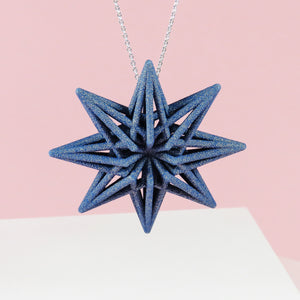 Starburts 3D Printed Pendant in sapphire blue on a fine silver chain