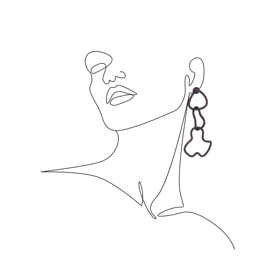 Mari Earrings on a sketch of a Woman