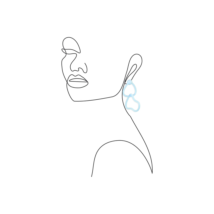 Mari Earrings in Aquamarine Blue on a sketch of a woman