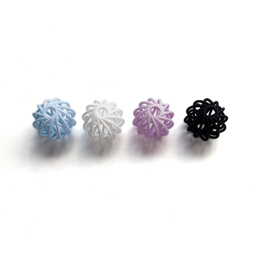 Our Deca Beads in Aquamarine Blue, Snow White, Amethyst Purple and Carbon Black