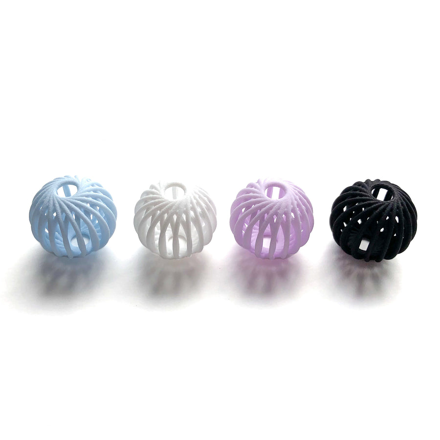 Our Kilo Beads in Aquamarine Blue, Snow White, Amethyst Purple and Carbon Black