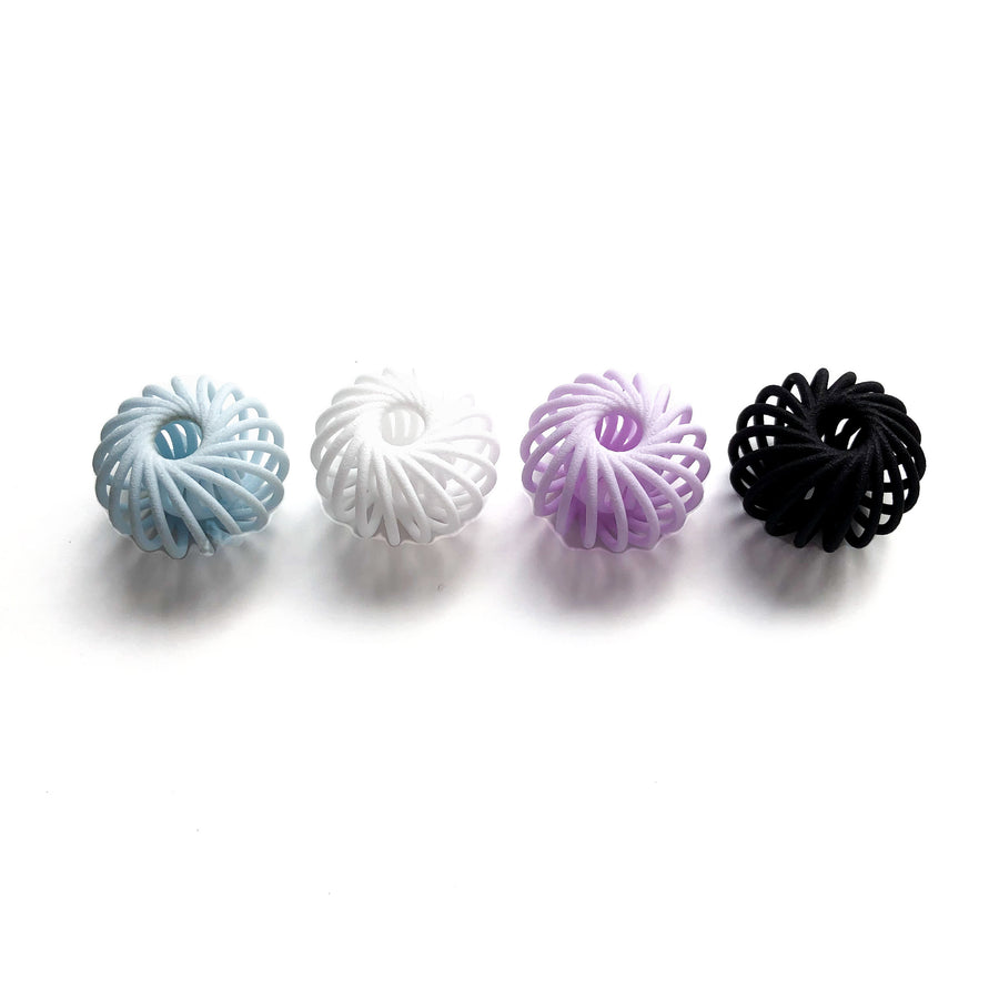 Our Milli Beads in Aquamarine Blue, Snow White, Amethyst Purple and Carbon Black