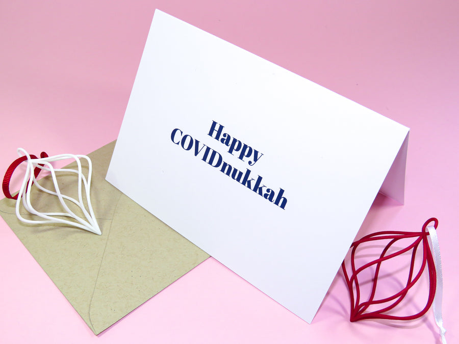 Hanukkah Greeting Card in Bright Blue Font reading