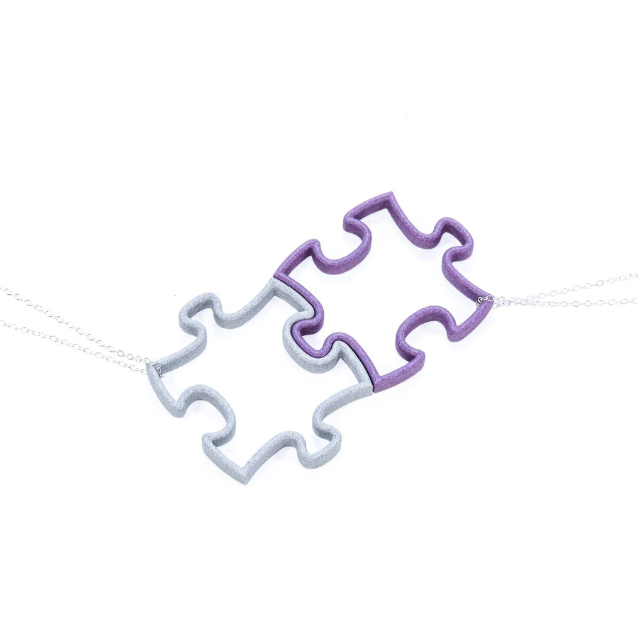 3D Printed interlocking puzzle pieces on a sterling silver chain