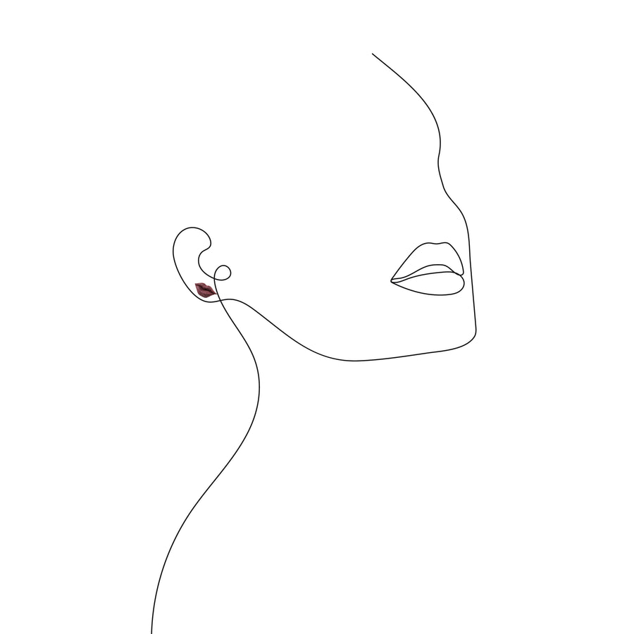 Kiss Earrings on a illustrated sketch of a female profile