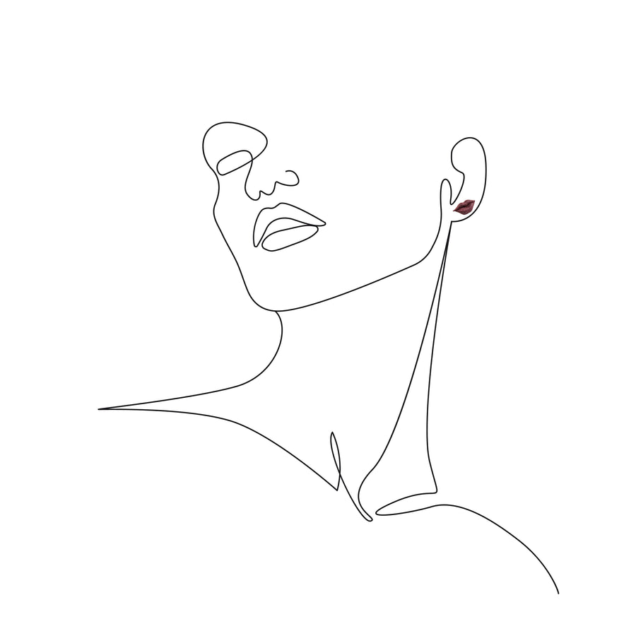 GAMENT Kiss Earring on a sketch of a woman's bust