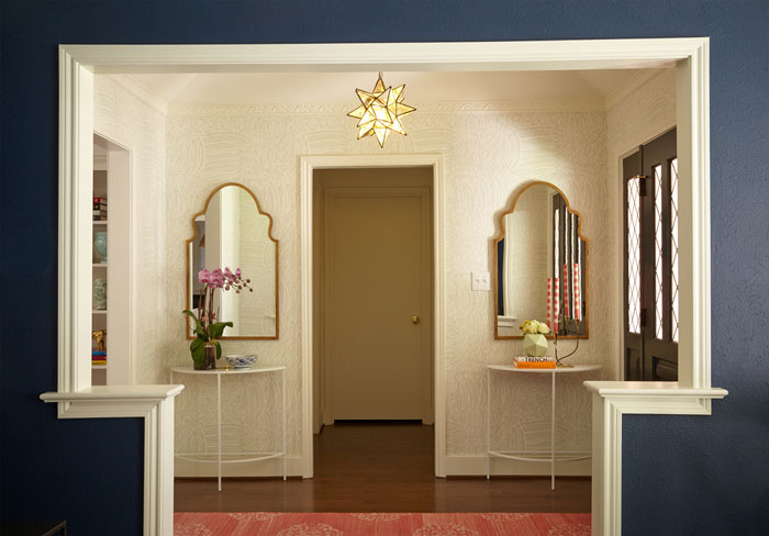 wallpapered entryway with two mirrors - interior designer Maddie Hughes